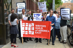 Union members deliver a letter to ITV Studios urging them to make a deal with the WGAE (ITV staffer at far left, in red shoes).
